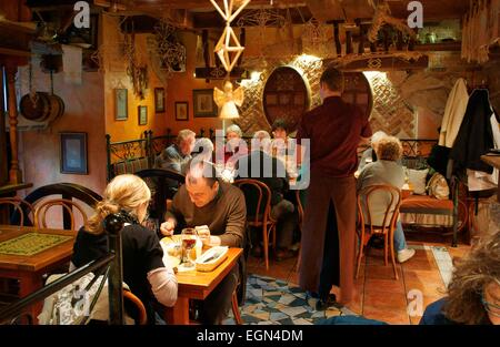 Riga Latvia. Diners and interior of Restaurant Salve on Town Hall Square. Traditional Latvian cuisine - Stock Photo