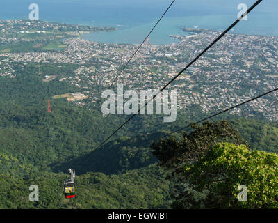 View down Puerto Plata from Mount Isabel de Torres National Park Teleferico cable car approaching top station Dominican - Stock Photo