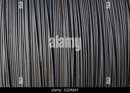 Texture formed by a thin metal fittings packed into riots in stock - Stock Photo