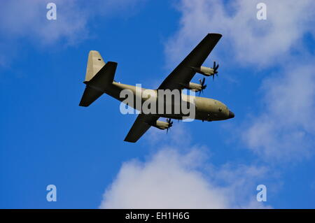 ZH880, 1999 Lockheed Martin C-130J Hercules flying over Loch lomond, Scotland. - Stock Photo