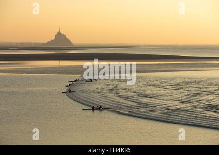 France, Manche, Mont Saint Michel bay, listed as World Heritage by UNESCO, a kayakists riding the Mascaret wave - Stock Photo