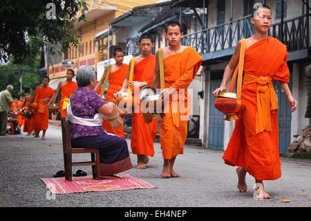 Laos, Luang Prabang, early morning alms giving to the monks - Stock Photo