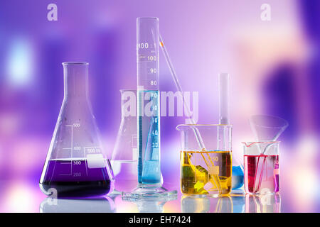 Laboratory tubes with colored liquids inside - Stock Photo