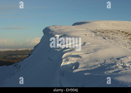 Sunset on  Helvellyn. Helvellyn winter, snow on Helvellyn Swirral Edge Cornices. Ice and snow sculptures - Stock Photo