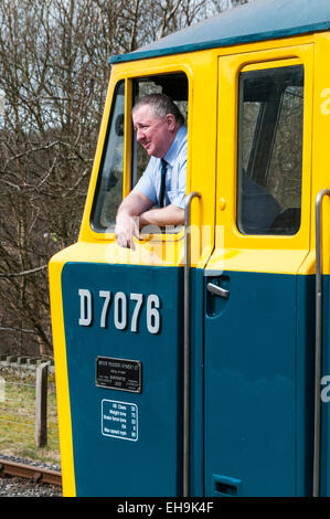 Train driver leaning out the drivers window of a Class 35 Hymek diesel loco in a 1970s railway scene on the East - Stock Photo