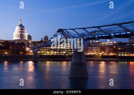 London 19 Aug 2013 : Saint Paul's Cathedral & Millennium Bridge illuminated at night on 19 Aug on The River Thames, - Stock Photo