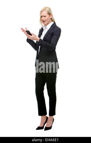 angry businesswoman shouting at mobile phone - Stock Photo