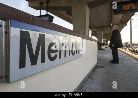 Merrick, New York, USA. 9th Mar, 2015. A man waits on the elevated platform of the Merrick Long Island Rail Road - Stock Photo