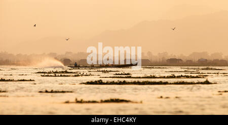 A motor boat on Inle lake at dusk, Inle Lake, Myanmar ( Burma ), Asia - Stock Photo