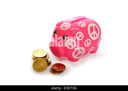 Piggy bank and coins on a white background. - Stock Photo
