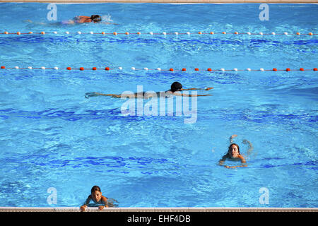 swimming in outdoor pool - Stock Photo