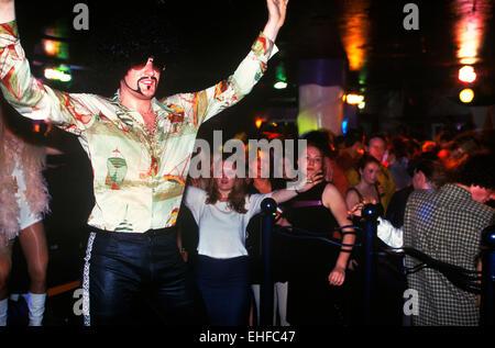 Guy in fancy dress in a nightclub on The Big Market in Newcastle. - Stock Photo