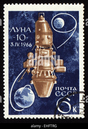 Postage stamp printed in USSR shows soviet spaceship Luna-10 - Stock Photo