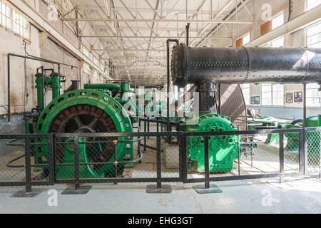 Compressors and generators in Sullivan Mine Powerhouse, Kimberley's Underground Mining Railway, Kimberley, BC, Canada - Stock Photo