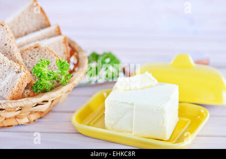 butter and bread on the wooden table - Stock Photo