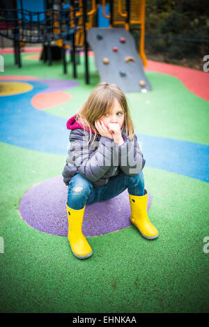 5 year-old girl in a playground. - Stock Photo