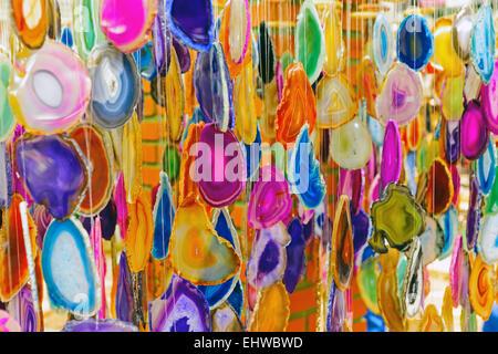 Colorful wind chimes made of semi-precious stones - Stock Photo