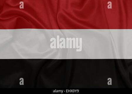 Yemen - Waving national flag on silk texture - Stock Photo