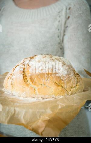Person holding fresh bread - Stock Photo