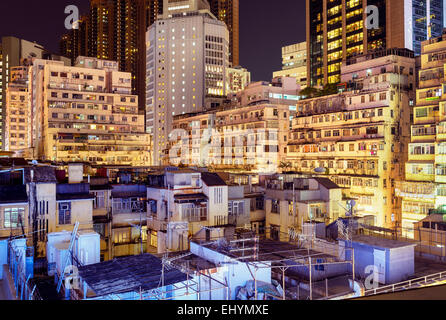 Apartment buildings at night in Hong Kong. - Stock Photo