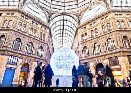 Naples, Italy - January 1, 2014: day view of tourists and locals in public shopping gallery Galleria Umberto I in - Stock Photo