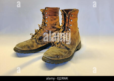 A very worn, very old pair of hiking or work boots from the early 1940s. - Stock Photo