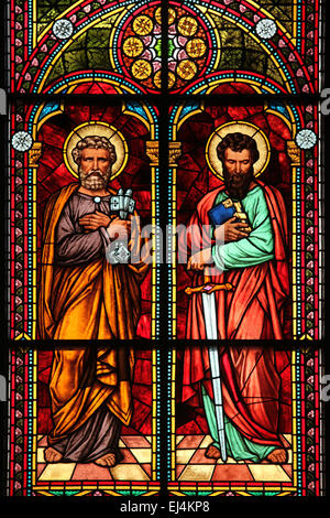 Saints Peter and Paul. Stained glass window by Dresden glass master Bruno Urban (1885) in the Riga Cathedral in - Stock Photo