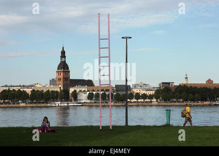 Pink ladder and the Riga Cathedral at the embankment of the River Daugava in Riga, Latvia. - Stock Photo