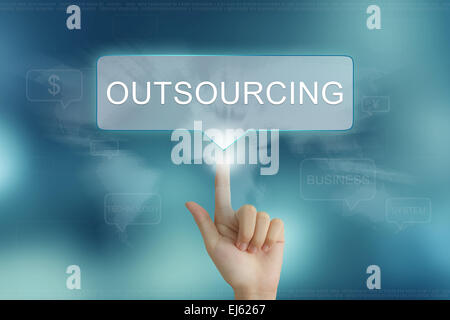 hand pushing on outsourcing balloon text button - Stock Photo