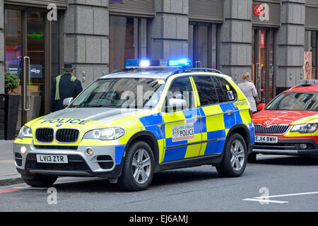 City of London BMW police car & crew attending a street emergency incident supporting paramedics City of London - Stock Photo