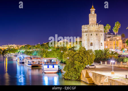 Seville, Spain at the Torre del Oro on the Guadalquivir River. - Stock Photo