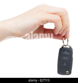 Male hand giving car keys - studio shot over white background - Stock Photo
