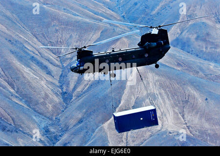 A U.S. Army CH-47 Chinook helicopter assigned to the 10th Combat Aviation Brigade and operated by Soldiers with - Stock Photo
