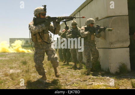 U.S. Army Soldiers engage simulated opposition forces while participating in Atlantic Strike V at the air-ground - Stock Photo