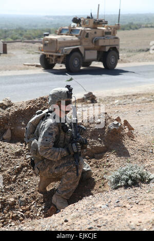 U.S. Army Spc. Albert Snow a Cavalry scout with 1st platoon Bravo Troop, 1st Squadron of the 172nd Cavalry Regiment - Stock Photo