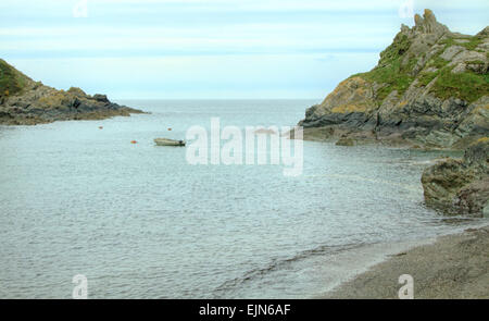 View from the harbor of Polperro overlooking the sea. Polperro is a fishing village on the coast of Cornwall, South - Stock Photo