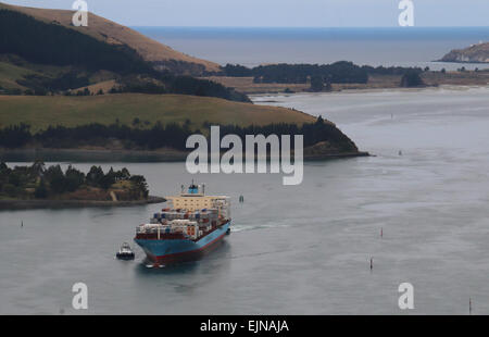 Container ship entering Port Chalmers New Zealand Otago Harbour - Stock Photo