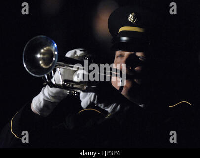 U.S. Army Spc. Harold Wilson plays Taps during the prisoner of war/ missing in action ceremony at the 50th Annual - Stock Photo