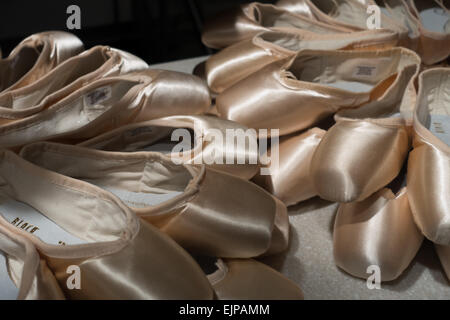 A Display of Pink Satin Ballet Shoes in Covent Garden - Stock Photo
