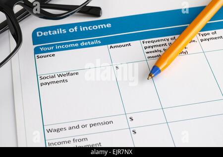 Details of income form with glasses and ballpoint pen. - Stock Photo