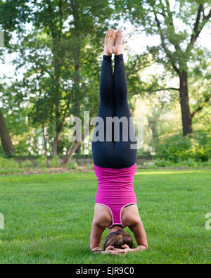 Caucasian woman practicing yoga in park - Stock Photo