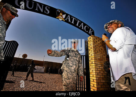 Giving a warm welcome, Command Sgt. Maj. Douglas Greene, center, from Harker Hieghts, Texas, the command sergeant - Stock Photo