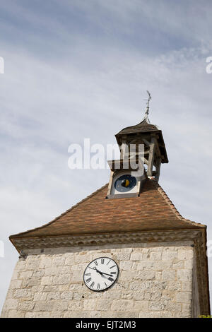Bell tower with weather vane, bell, lunar phase indicator and clock in Tournon-d'Agenais, France. - Stock Photo