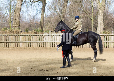 Soldiers on Horseback at the Household cavalry training ground - Stock Photo