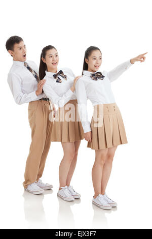 Three high school students are surprised to see to the side - Stock Photo