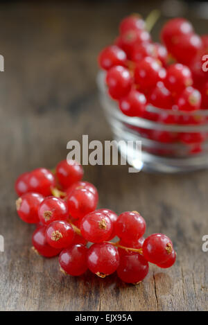 Red currants isolated on old wood - Stock Photo