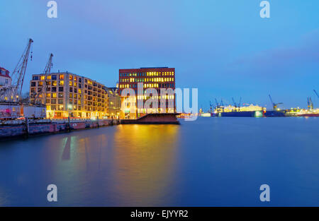 Docks and office buildings at the banks of the river Elbe in Hamburg, Germany - Stock Photo
