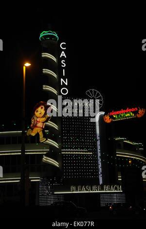 Night portrait Nickelodeon 'Dora the Explorer' image in front of electric lights Pleasure Beach Casino, Blackpool - Stock Photo