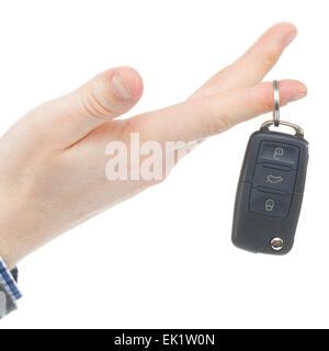 Male hand giving car keys - studio shot on white - Stock Photo