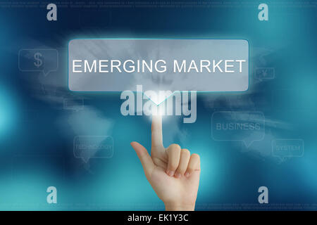 hand pushing on emerging market balloon text button - Stock Photo